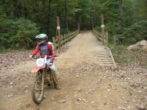 Randy Gray pauses at the foot of a bridge at Carolina Adventure World