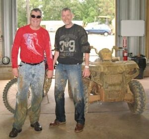 Randy Gray and Malcolm Logan covered with mud after riding at Carolina Adventure World
