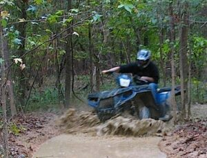 I drove the ATV through the mud, twisting the throttle for all I was worth.