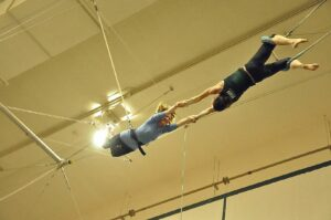 Joan Anundsen being caught by Kris of New York Trapeze School in Chicago.