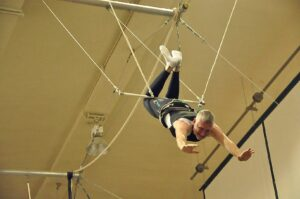 Malcolm Logan on the flying trapeze at New York Trapeze School in Chicago.