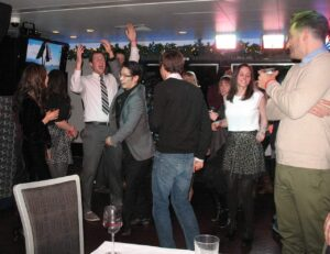 Dancing at the office Christmas party aboard the Mystic Blue in Chicago