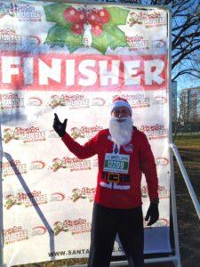 Malcolm Logan dressed as Santa Claus at the Santa Hustle 5K in Chicago