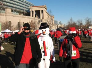 Frosty the Snowman and friends at Solider Field for the Santa Hustle 5K