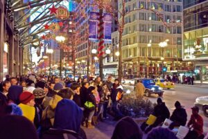 A crowd gathers to watch the drummers outside the Macy's store on State Street in Chicago