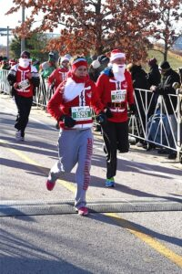 Malcolm Logan approaches the finish line at the Santa Hustle 5K in Chicago