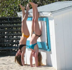Two lithesome girls frolic on the beach in Miami.
