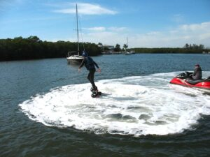 Malcolm Logan rising and falling over the surface of the water at FMB Flyboard