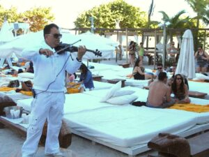 A musician plays at the Nikki Beach Club in Miami