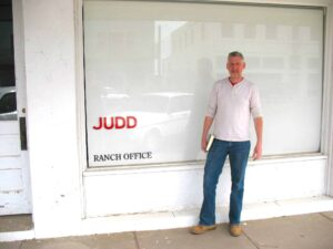 Malcolm Logan standing outside the Judd office in downtown Marfa.