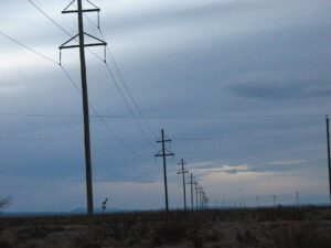 Telephone poles stand eerily against the dusk near the viewing platform for the Marfa Mystery Lights.