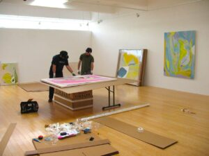 Two artists prepare for an opening at the Marfa Book Company