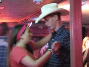 Young man and girl dancing at The Broken Spoke in Austin, TX