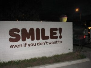 Smile sign in Austin: Smile even if you don't want to.