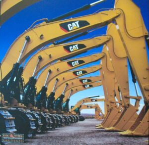 Excavators lined up at Dig This: The Heavy Equipment Playground