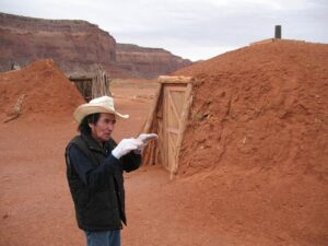 Don Mose at a Navajo hogan