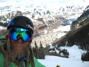 Jaimé Palmer with the town of Telluride, Colorado below him