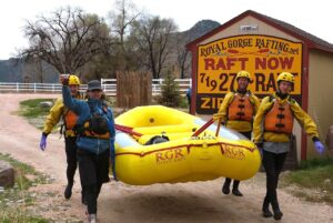 Carrying our boat to the river with Royal Gorge Rafting