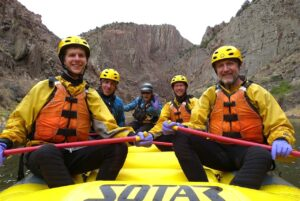 Four men river rafting on the Arkansas river with Royal Gorge Rafting