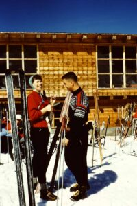 Skiers at mountainside lodge about 1955