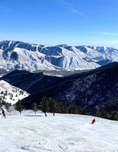 Sun Valley loan skier in red