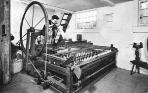 A boss spinner works at a Spinning Jenny.