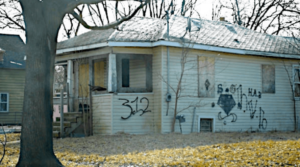 Vacant house tagged with gang signs on Flint's east side.